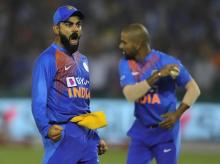 Virat Kohli and Shikhar Dhawan celebrate after Quinton de Kock's wicket