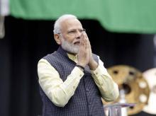 PM Narendra Modi acknowledges the crowd as he takes the stage during the Howdi Modi event, Sept 22, 2019, at NRG Stadium in Houston. (Photo: AP/PTI)
