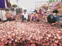 Onions sellers in a market