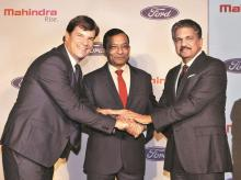 Jim Farley, president of Ford's new businesses, with M&M MD Pawan Goenka and Mahindra Group Chairman Anand Mahindra at a news conference in Mumbai. (Photo: PTI)