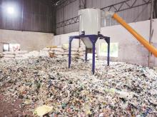 Multilayered plastic waste is weighed and collected from waste collectors in Pune. Photo: ITC
