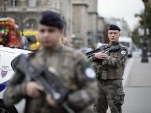 Armed soldiers patrol after an incident at the police headquarters in Paris, Thursday, Oct. 3, 2019. A French police union official says an attacker armed with a knife has killed one officer inside Paris police headquarters before he was shot and kil