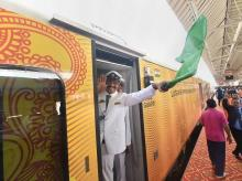Lucknow: The guard of the Lucknow-Delhi Tejas Express, India's first 'private' train by IRCTC (Indian Railway Catering and Tourism Corporation), waves the green flag after its was flagged off from the Charbagh Railway station in Lucknow, Friday.