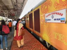 Lucknow: Passengers near the Lucknow-Delhi Tejas Express, India's first 'private' train by IRCTC (Indian Railway Catering and Tourism Corporation), during its flag-off ceremony at the Charbagh Railway station in Lucknow, Friday, Oct. 4, 2019.