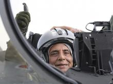 Bordeaux:  Indian Defense Minister Rajnath Singh thumbs up as he sits in a Rafale jet fighter during an handover ceremony at the Dassault Aviation plant in Merignac, near Bordeaux, southwestern France, Tuesday, Oct. 8, 2019.