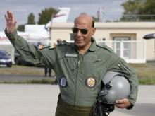 Bordeaux:  Indian Defense Minister Rajnath Singh gestures before a test flight in a Rafale jet fighter at the Dassault Aviation plant in Merignac, near Bordeaux, southwestern France, Tuesday, Oct. 8, 2019.