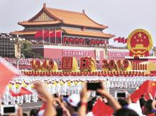 A float featuring China's national emblem travels past Tiananmen Gate during the parade celebrating 70 years of Communist party rule in Beijing             REUTERS