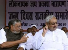 Patna: Bihar Chief Minister Nitish Kumar and  his Deputy Sushil Kumar Modi at the birth anniversary celebration of socialist leader Jaiprakash Narayan, in Patna, Friday, Oct. 11, 2019. (PTI Photo) (