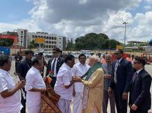 Prime Minister Narendra Modi being welcomed by Tamil Nadu Deputy Chief Minister O Panneerselvam as Chief Minister K Palaniswami looks on, on his arrival in Chennai, Friday, Oct. 11, 2019