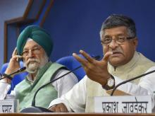 Communications and IT minister Ravi Shankar Prasad (right) at a press conference with Minister of Housing and Urban Affairs Hardeep Singh Puri