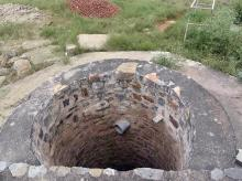 A Mughal-era well near the Arab ki Sarai baoli has a pipe at its mouth to collect rainwater. Photo: Dalip Kumar