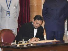 New Delhi: Justice Sharad Arvind Bobde signs on a register after taking oath as the 47th Chief Justice of India (CJI) at Rashtrapati Bhavan, in New Delhi, Monday, Nov. 18, 2019 | (PTI Photo/Manvender Vashist)