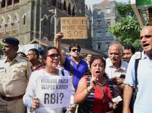 PMC account holders protest outside High Court premises over the bank's crisis, in Mumbai | PTI