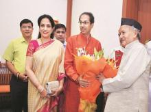 Maharashtra Governor Bhagat Singh Koshyari with CM-designate Uddhav Thackeray and his wife Rashmi Thackeray at Raj Bhavan in Mumbai