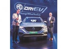 MG Motor India president & MD Rajeev Chaba (left) unveiling the company's electric car model ZS