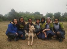 Students of team Pasitivity with Ellie and owner of the dog shelter