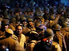 Police in riot gear stand guard inside the Jawaharlal Nehru University (JNU) after clashes between students in New Delhi, India, January 5, 2020.