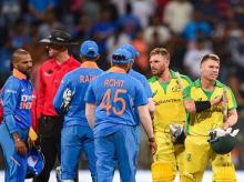 Australian batsman David Warner and Aaron Finch being congratulated by Indian players after they chased down the target to win the first one day international (ODI) cricket match at the Wankhede Stadium in Mumbai. Photo: PTI