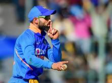 India's Virat Kohli reacts as he celebrates after taking a catch for the dismissal of Australia's Marnus Labuschagne during the third and final ODI cricket match, at Chinnaswamy Stadium in Bengaluru. Photo: PTI