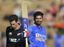 India's Shreyas Iyer celebrates his century as New Zealand's Mitchell Santner looks on during the 1st ODI between India and New Zealand at Seddon Oval in Hamilton. File Photo: AP | PTI