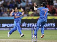 India's Poonam Yadav, left, celebrates with teammate Harmanpreet Kaur after taking the wicket of Australia's Jess Jonassen during the first game of the Women's T20 Cricket World Cup in Sydney. File Photo: AP | PTI
