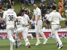 New Zealand's Trent Boult, second from right, celebrates the dismissal of India's Mayank Agarwal for 34 during the first cricket test between India and New Zealand at the Basin Reserve in Wellington, New Zealand. Photo: AP | PTI