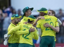 South Africa's batsman Anrich Nortje, rear right, celebrates with teammates after bowling the last delivery at the end of the 2nd T20 cricket match between South Africa and Australia at St George's Park in Port Elizabeth, South Africa. File Photo: AP