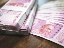 Rupee settles 78 paise higher at 75.16 a dollar on stimulus boost