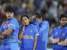 Indian players gather together after its loss to Australia in the Women's T20 World Cup cricket final match in Melbourne. File Photo: AP   PTI