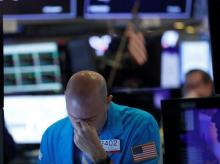 A trader reacts as he works on the floor of the New York Stock Exchange (NYSE) in New York City. Reuters