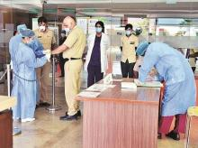 A policeman with fever being given an orange band before he reports to the flu clinic at Fortis Hospital, Gurugram Photo: Sanjay K Sharma