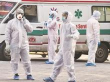 health workers, doctors, protective suits, PPE, masks, ambulance, coronavirus