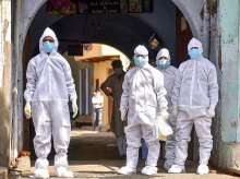 Medics in protective suits are seen in a containment zone during the ongoing Covid-19 pandemic, in Aligarh, Saturday, May 2, 2020. (PTI Photo)