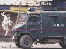 Pulitzer winning picture by AP journalist, Kashmir, J&K Police, protest, armoured vehicle