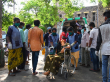An affected woman on a wheelchair being taken for treatment at King George Hospital after a major chemical gas leakage at LG Polymers industry in RR Venkatapuram village, Visakhapatnam. Photo: PTI