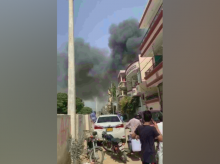 Plumes of smoke can be seen rising form the site of the crash in Karachi. (Source: DAWN)