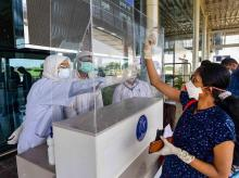 A passenger undergoes screening after arriving at Kempegowda International airport for domestic travel, during the ongoing COVID-19 nationwide lockdown in Bengaluru. Photo: PTI
