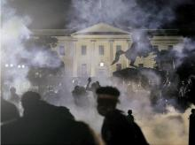 A protest outside the White House against the killing of George Floyd. Following the violent protest, US President Donald Trump was forced to take shelter in the White House bunker. US has put nearly 40 cities under curfew and arrested 4,000. Reuters