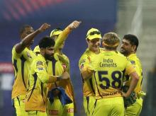 CSK players react after the wicket of Mumbai Indians player Quinton de Kock during the first cricket match of IPL 2020, at Sheikh Zayed Stadium, Abu Dhabi, UAE. Photo: PTI