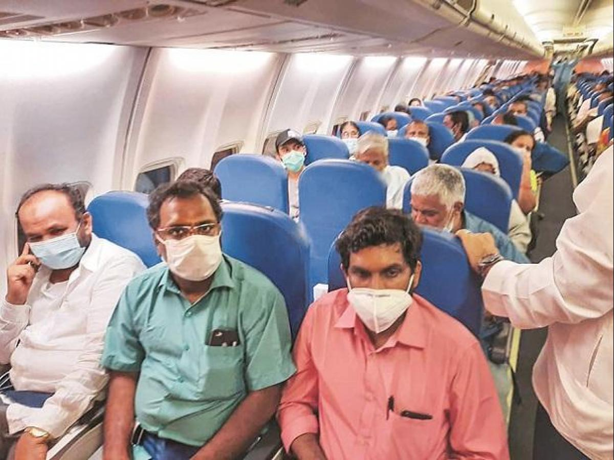 19 Indian passengers test Covid positive in Air India's Delhi-Wuhan flight  | Business Standard News