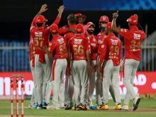 KXIP celebrates after the wicket of Dinesh Karthik at Sharjah on Monday