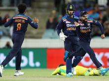 Virat Kohli celebrates after Carey gets runout. Photo: @BCCI