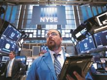 Wall Street subdued at open as stimulus rally cools on bets of a snap-back