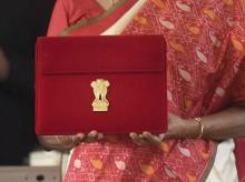 Finance Minister Nirmala Sitharaman holds a case containing a tablet device, during the Budget Session of the Parliament