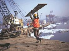 DFI, infrastructure, construction, workers, labour