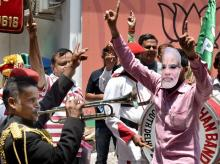BJP supporters celebrate the party's performance in Assembly polls of the five states, at party headquarters in New Delhi
