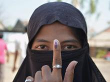 A muslim women displays the indelible ink mark on her finger after casting her vote in the polling booth for Zilla Parishad Panchayat Samiti election at Saidapur Village in Karad,Maharashtra on Tuesday.