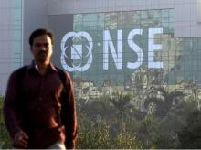 A man walks past the NSE (National Stock Exchange) building in Mumbai on December 27, 2016. (Photo: Reuters)