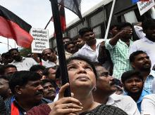 DMK MP Kanimozhi, VCK leader Thol Thirumavalavan and others during a bandh condemning the police action against protesters in Tuticorin, in Chennai on Friday