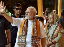 Prime Minister Narendra Modi waves as his  Bangladeshi counterpart Sheikh Hasina looks on after attending convocation of the Visva Bharati University at Santiniketan, on Friday.